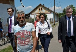 """Michael Georg Link, ODIHR Director, and Mirjam Karoly, Senior Adviser on Roma and Sinti Issues, are led through the """"Numbered Streets"""" neighbourhood by local Roma activists during the field assessment visit to Miskolc, Hungary, on 1 July 2015. Copyright OSCE-ODIHR."""